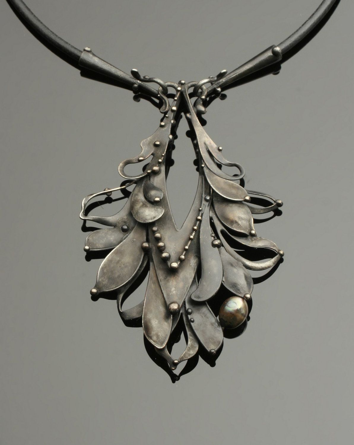 Necklace   Katia Pfipsen Olivova.  Black pearls in mixed metal (sterling silver, copper and lead-free solder) hung on black leather cord. LOVE!