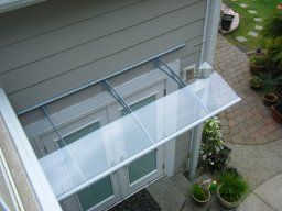 awnings canopies s canada door awning carports grande for sale aquila palram cover patio clear