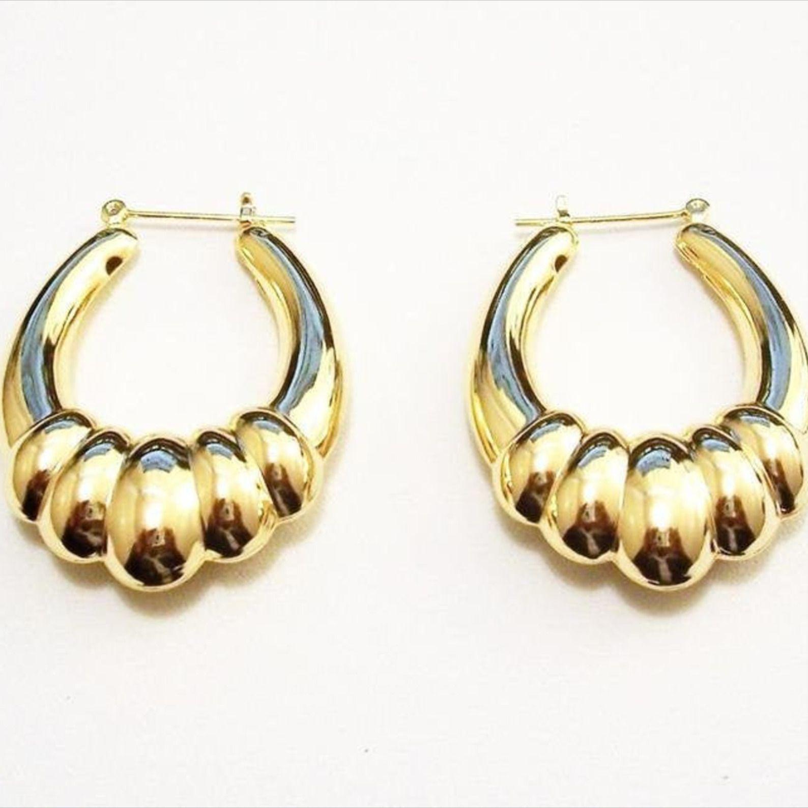 Monet ribbed shrimp style hoop clip on earrings in gold tone metal