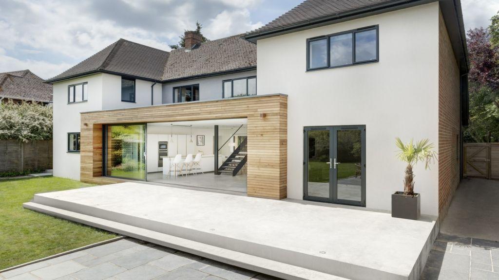 Offenes Wohnzimmer mit edler Küche im Altbau architektur - haus renovierung altgebaude