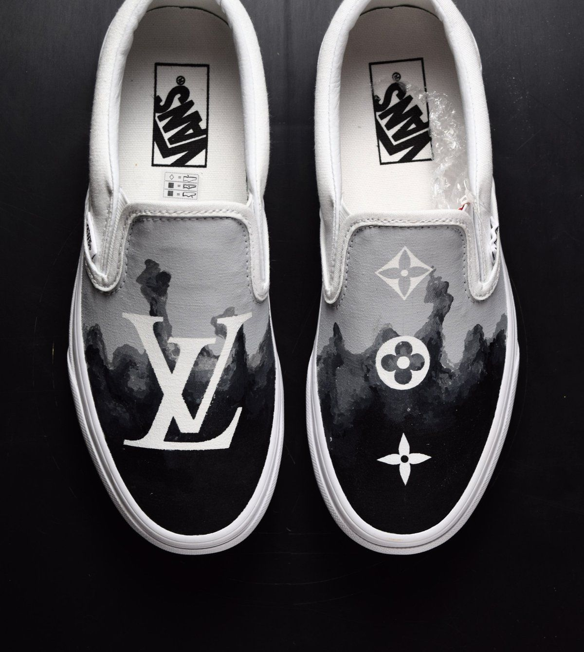 Introducing our hand painted black smoke Louis Vuitton slip on Vans custom  sneaker. The all 600a1efe8
