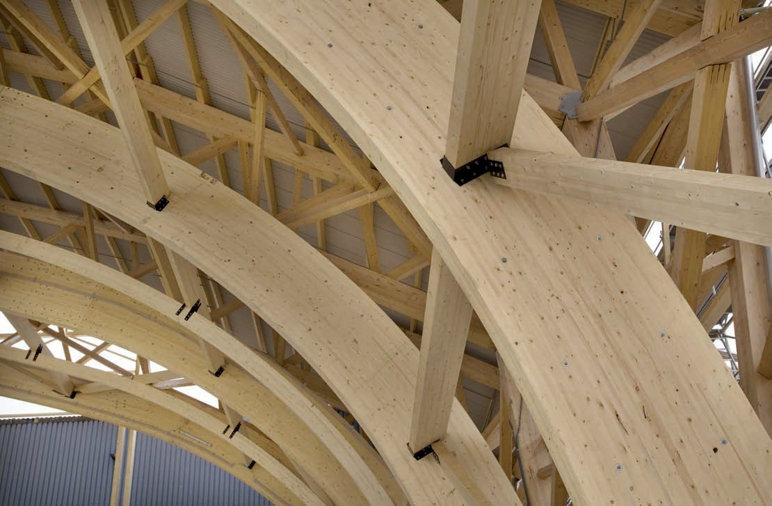 The glulam frame of a mathis built aircraft hangar image for Why is wood sustainable