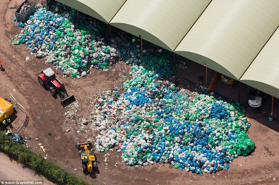 Rubbish bags galore: This was the scene above Worthy Farm in Somerset as rubbish bags were...