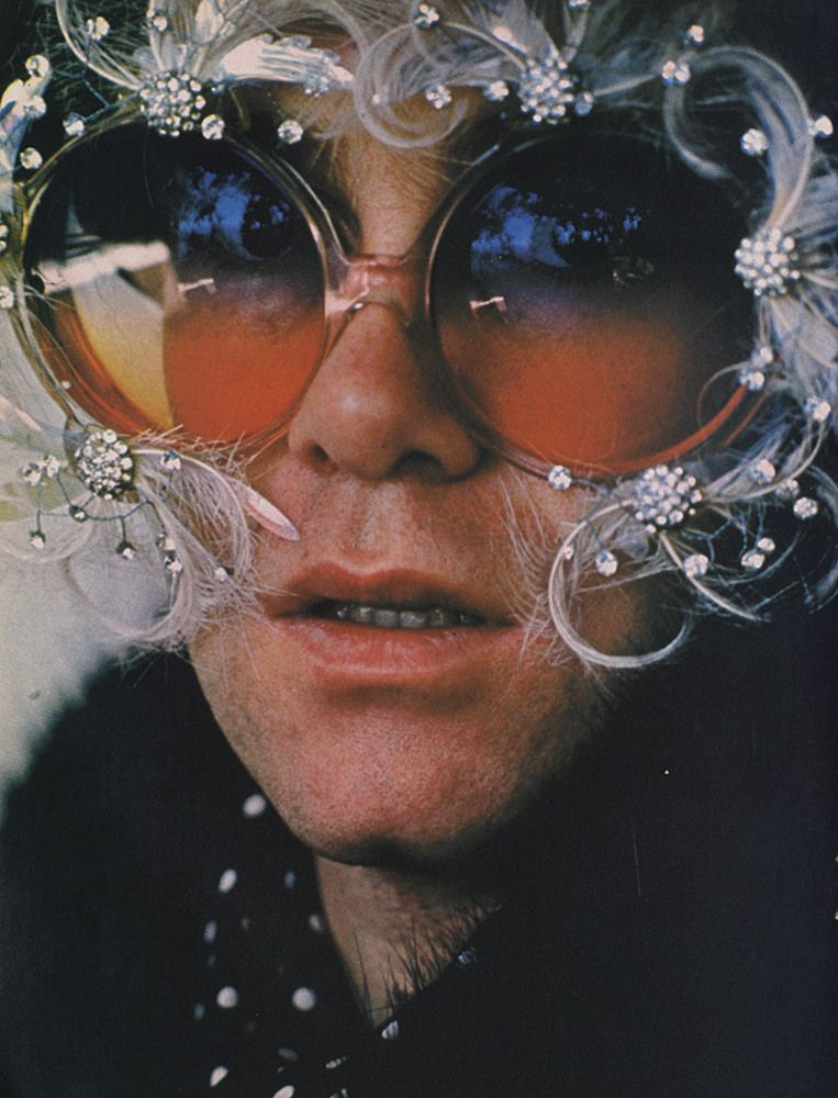 b4a72e4d2d A young Elton John from the 70 s  Elton was know for his over the top glam  wardrobe when performing.