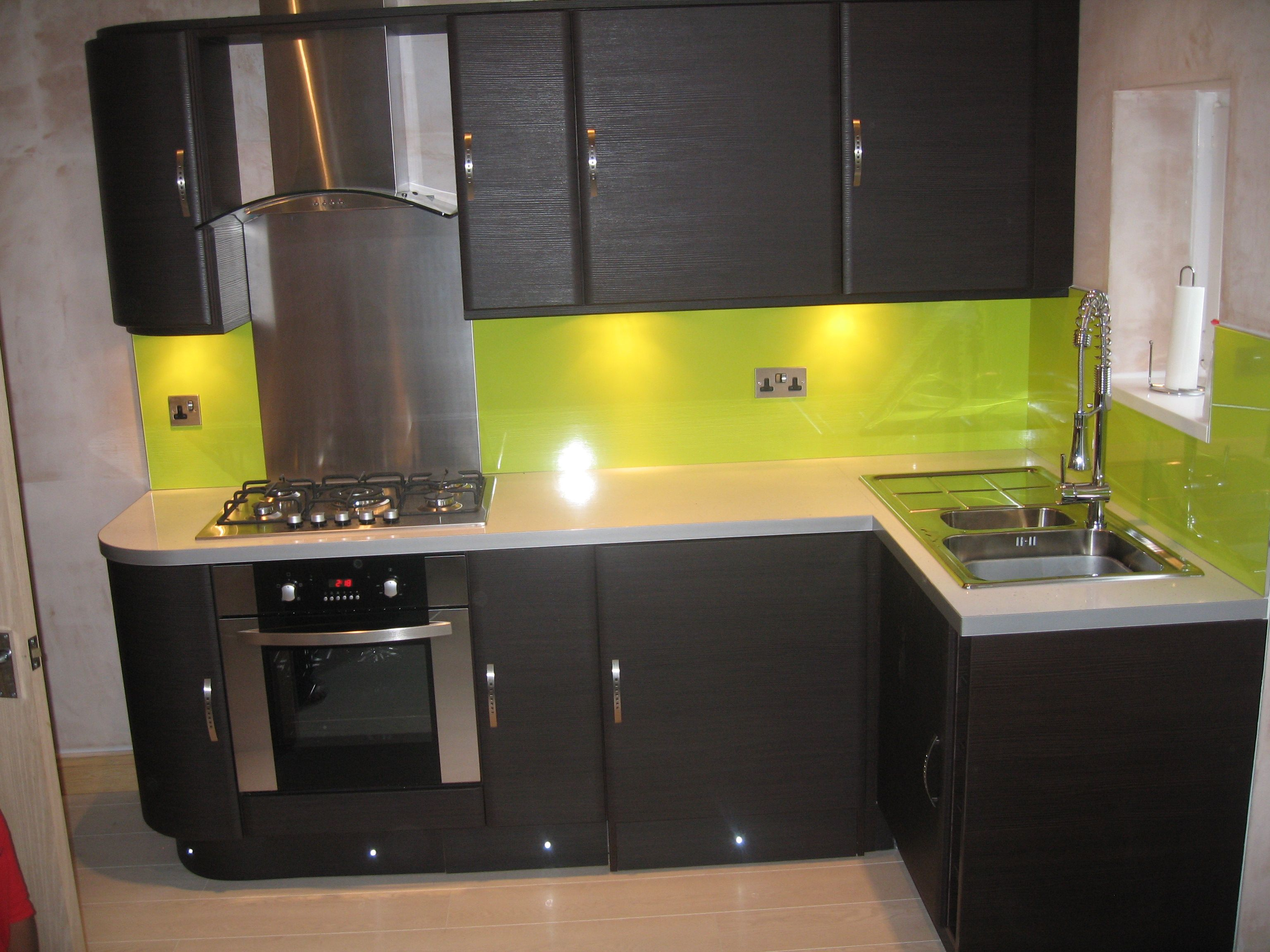 Lime green ceramic tiles backsplash also black kitchen Modern green kitchen ideas