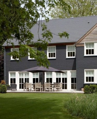 exterior house paint black scandi dark grey cladding white windows and natural timber