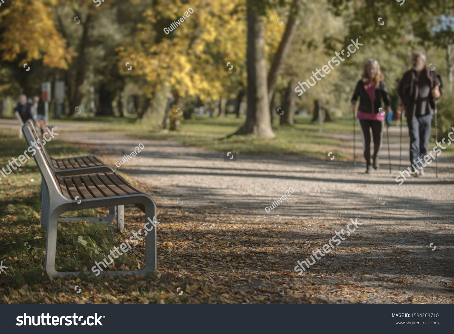 Park in autumn wit two people and walking sticks #Ad , #AFF, #wit#autumn#Park#sticks