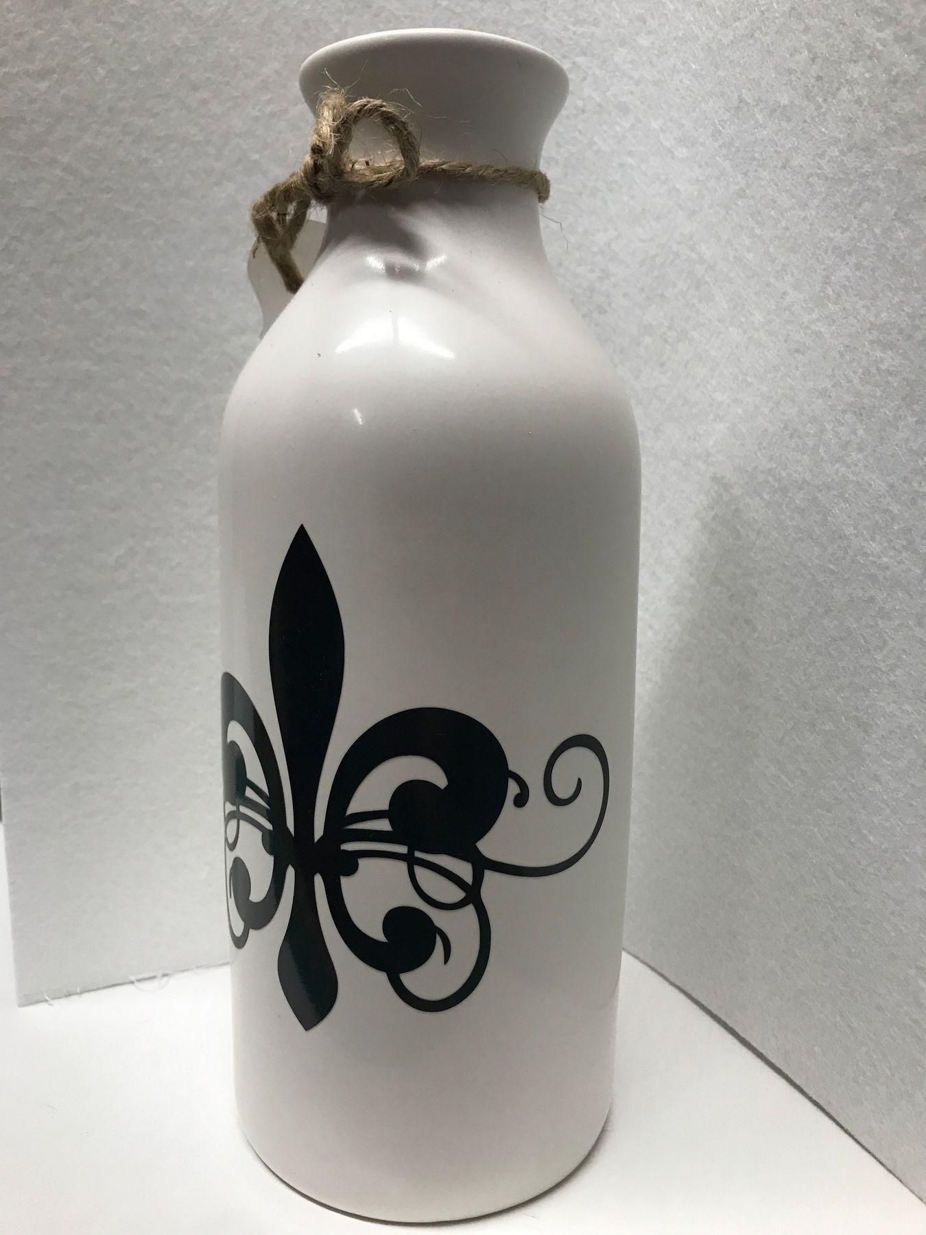 Fleur De Lis Milk Bottle Vase 10 in tall. A charming way