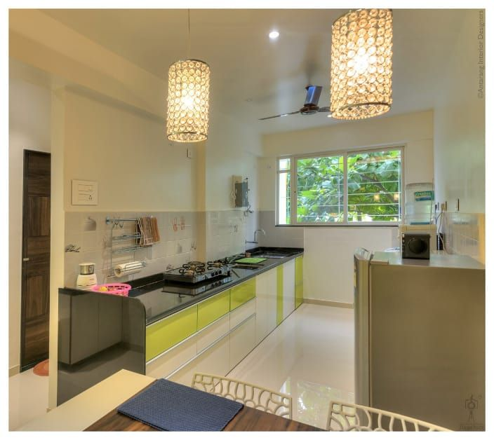 Modish Modular Kitchen With Green And White Cabinets Urbanclaphomes