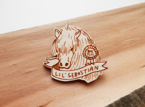 A wooden engraved brooch inspired by the brilliant Parks ...