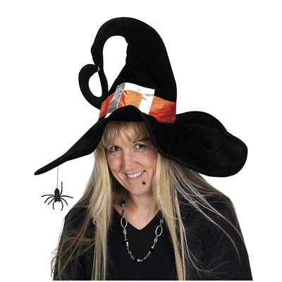 Doesn't she look happy with her new witch hat?
