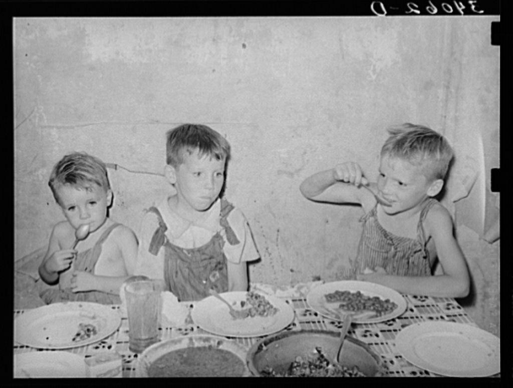 Children of unemployed oil worker eating supper. Seminole