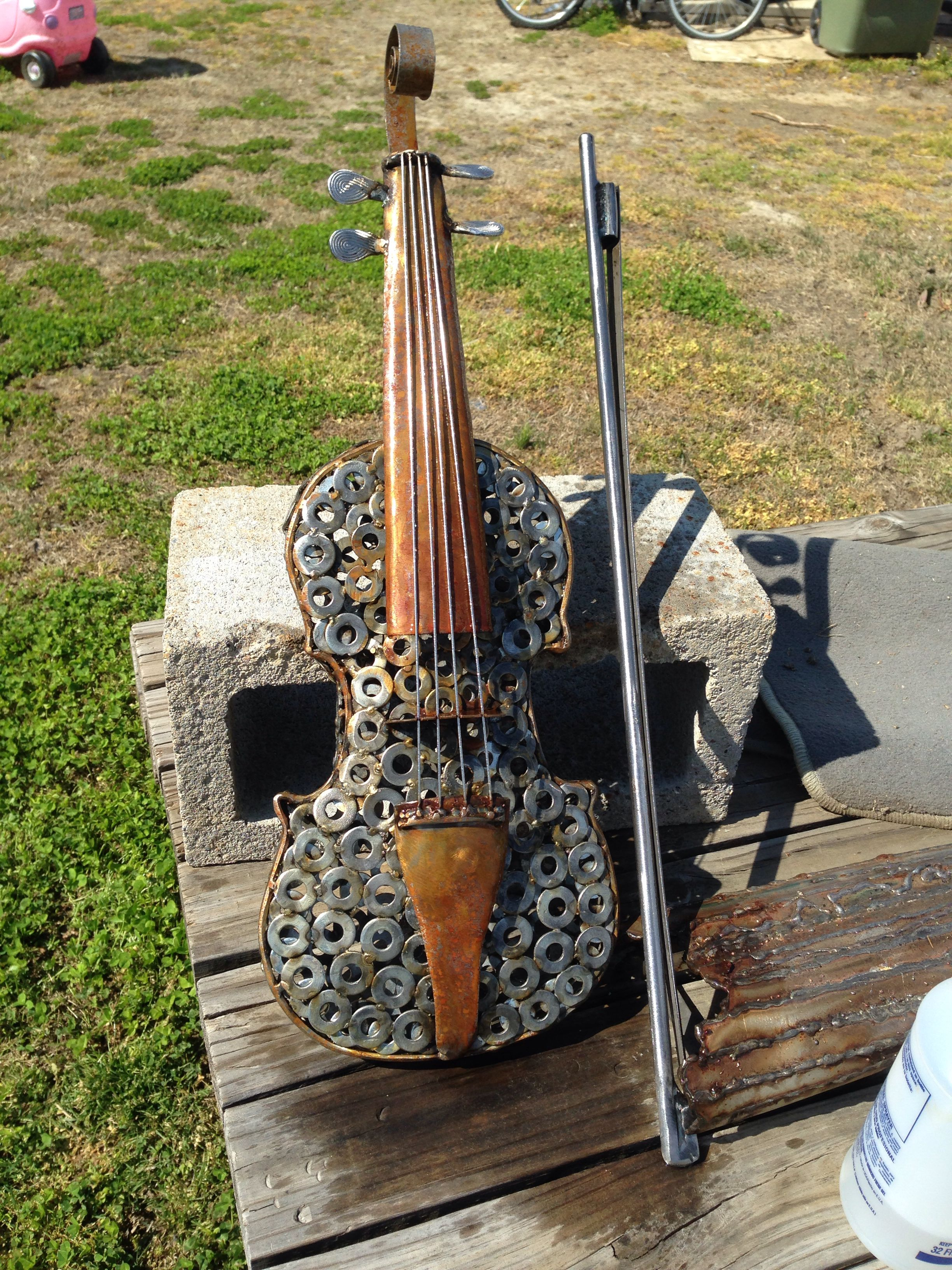Rusted metal art sculpture by kelly stevens violin