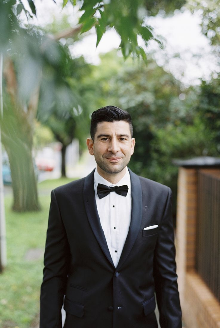 Groom in black tuxedo for A Big Fat Greek Winter Wedding | I take you