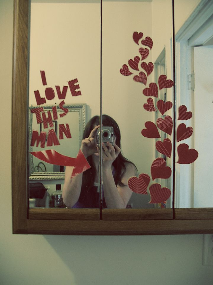 Valentines Day idea use paper and tape to make a bathroom mirror