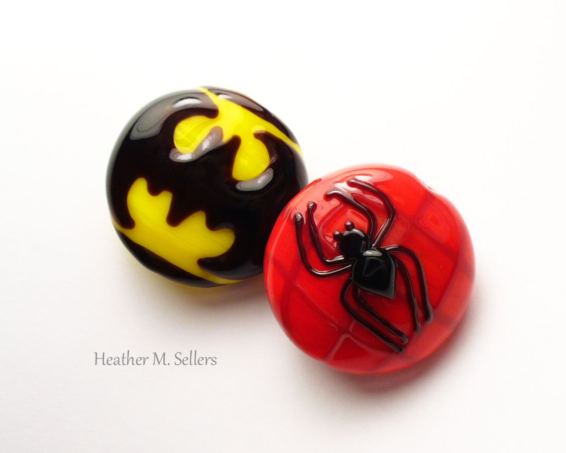 Batman vs. Spiderman by Heather Sellers. Lampwork glass beads made to donate to Beads of Courage. #beadsofcourage #superhero #batman #spiderman #heathersellers #glass #lampwork