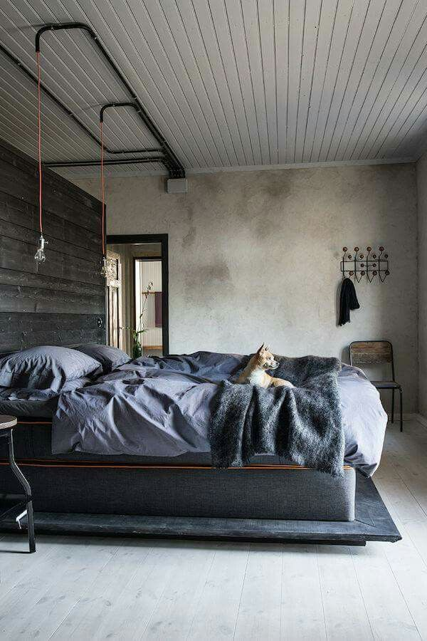 Industrial style bedroom with cozy bed and