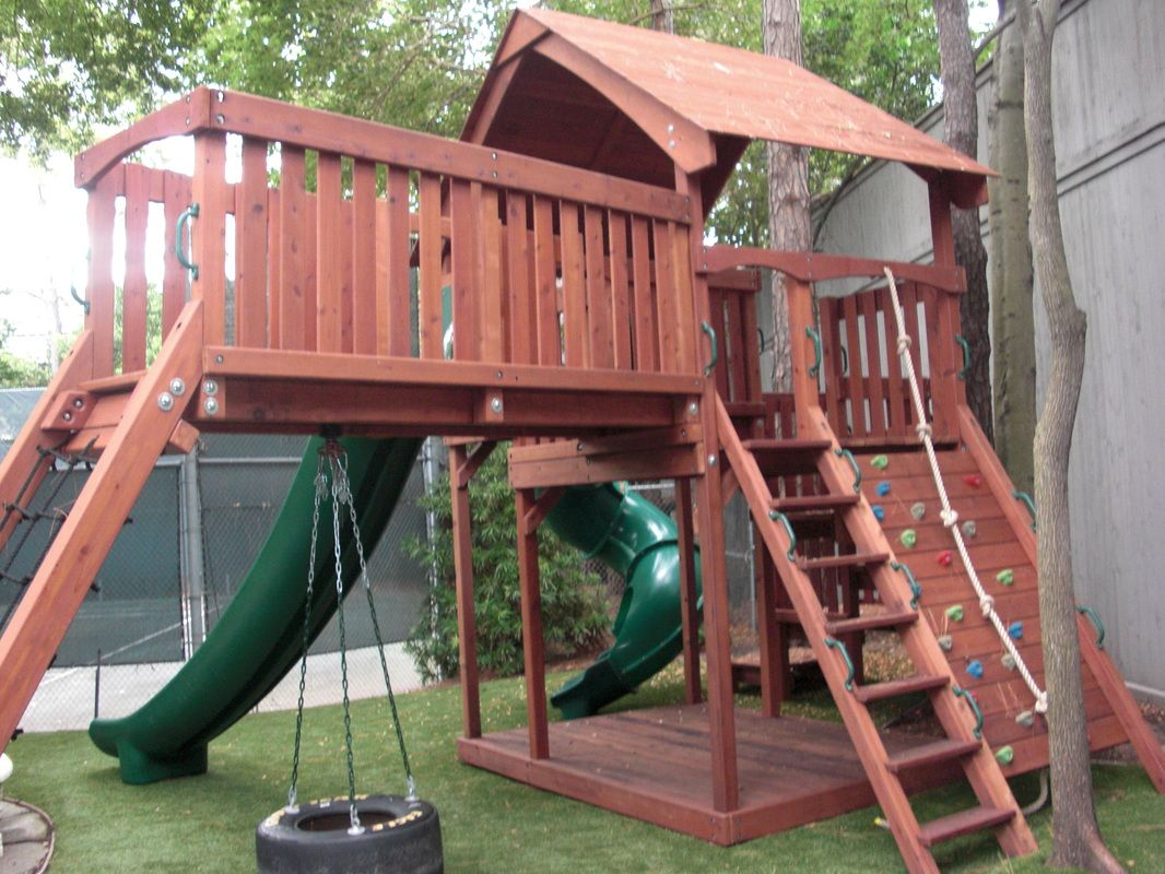 redwood fort with bridge cargo climb rock wall tire swing