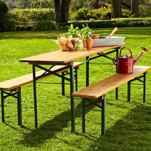 saw one at The Upper Rust recently, dressed-up with a piece of canvas stretched over the wood table top and secured beneath with staples...vintage biergarten table (Williams Sonoma)