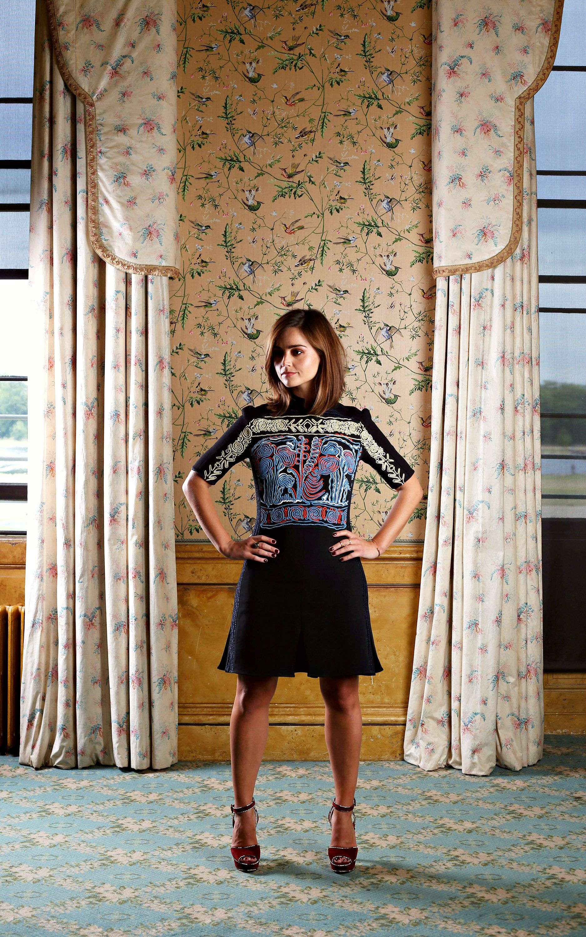 Jenna Coleman daringly takes the plunge in low-cut leg