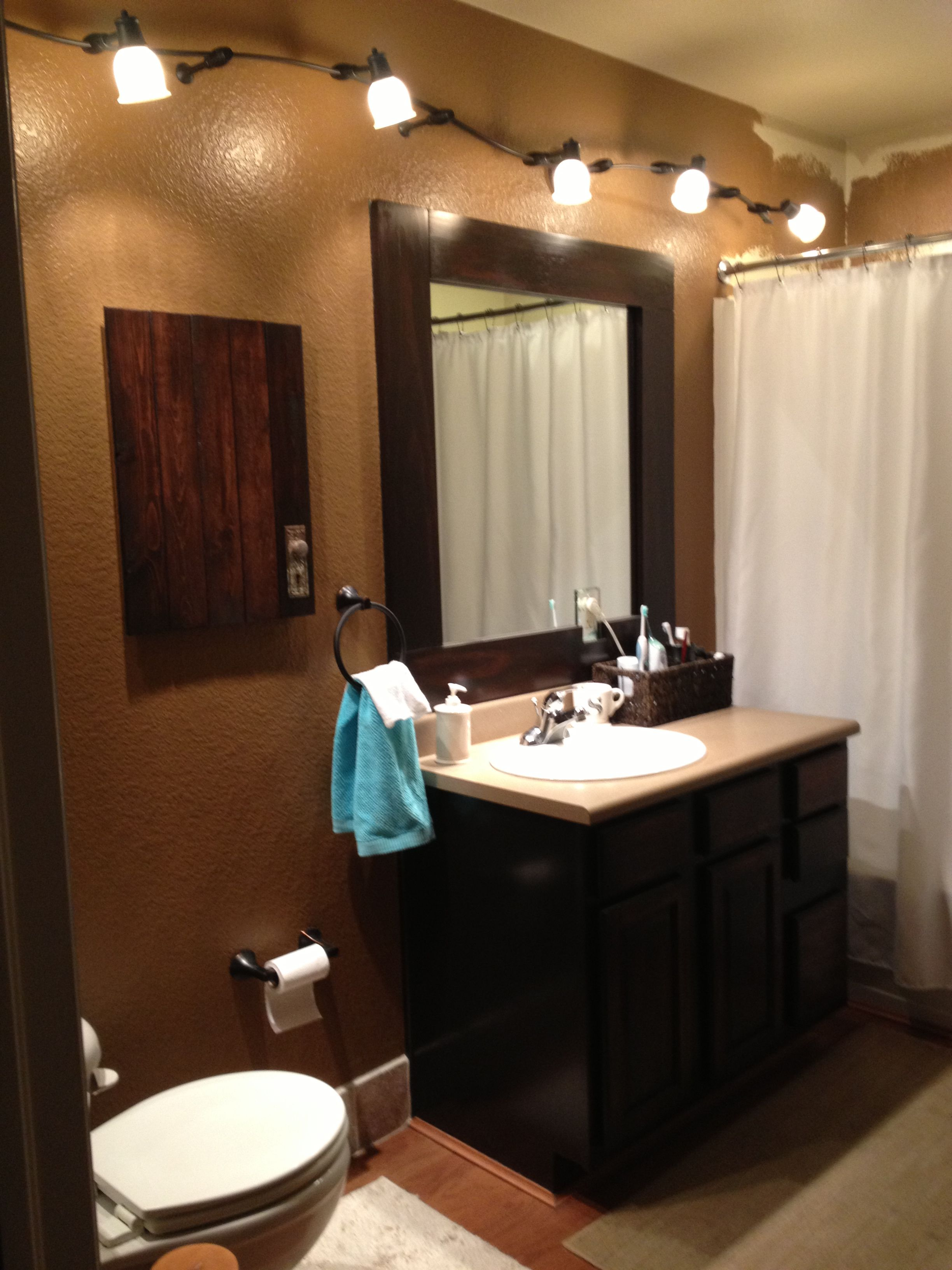 Bathroom Mirror Java java gel stain over oak cabinets with a java-trimmed mirror
