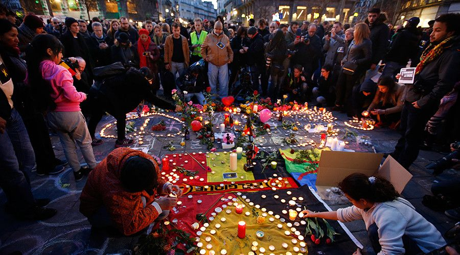People gather around a memorial in Brussels following bomb attacks in Brussels, Belgium, March 2016.