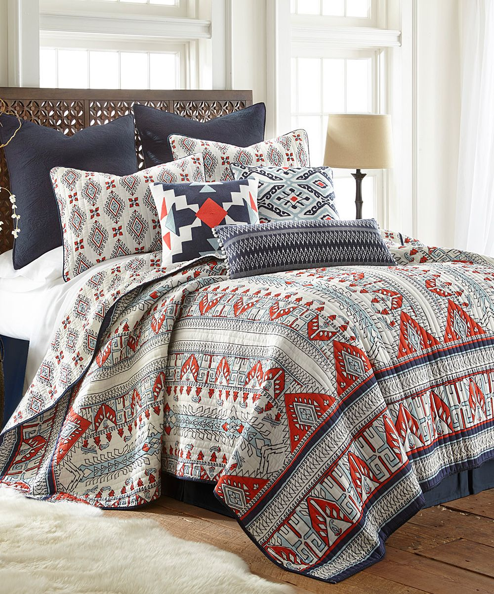 Earthen Hues And A Geometric Pattern Give This Quilt Set A