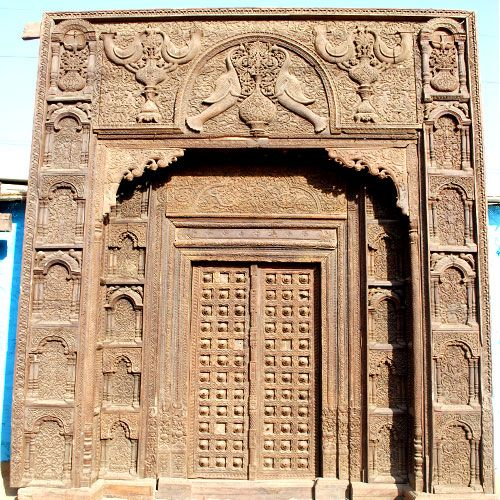 turn your home into your castle with the new delhi palace decorative hand carved door this ornate entrance features intricate multi layered details carved