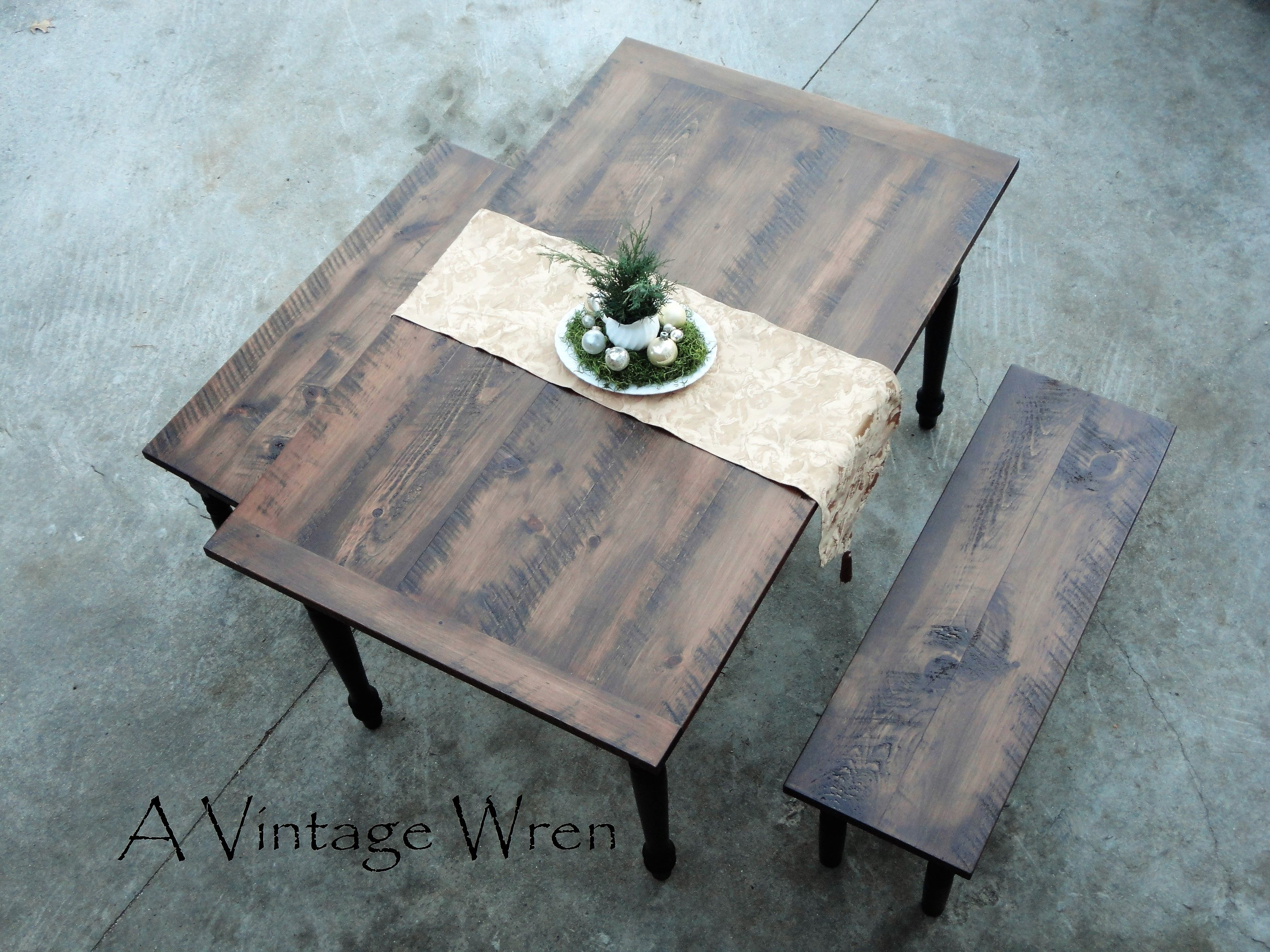 """Custom built farm table, made in New Hampshire.  https://www.facebook.com/AVintageWren An Eastern White Pine farm table with 2 matching benches. The top is our rougher circular sawn top stained walnut, the legs painted black with no distressing. These pieces are from our """"Heirloom Collection"""""""