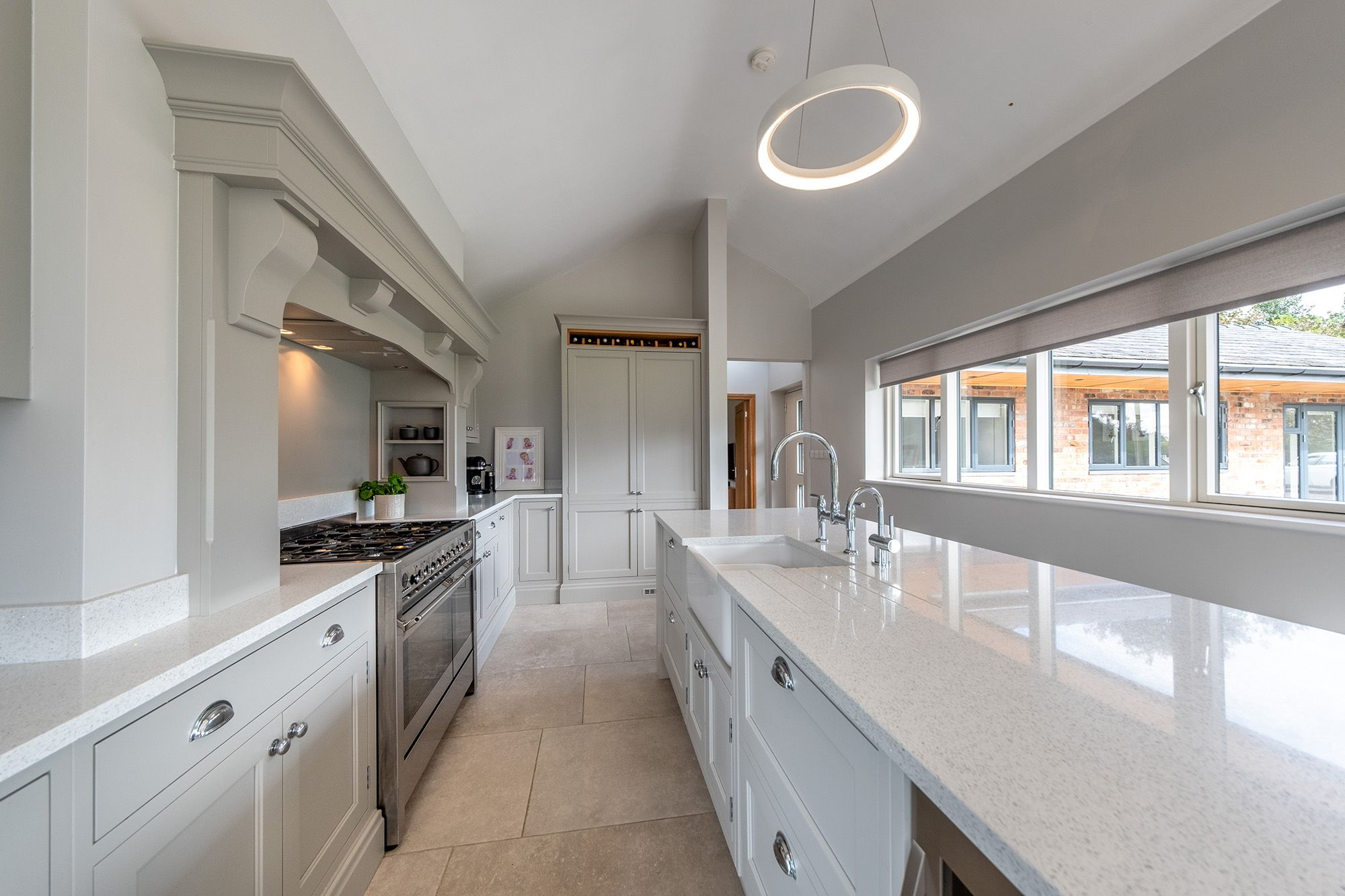 Modern kitchen with vaulted ceiling large island and range cooker #vaultedceilingdecor