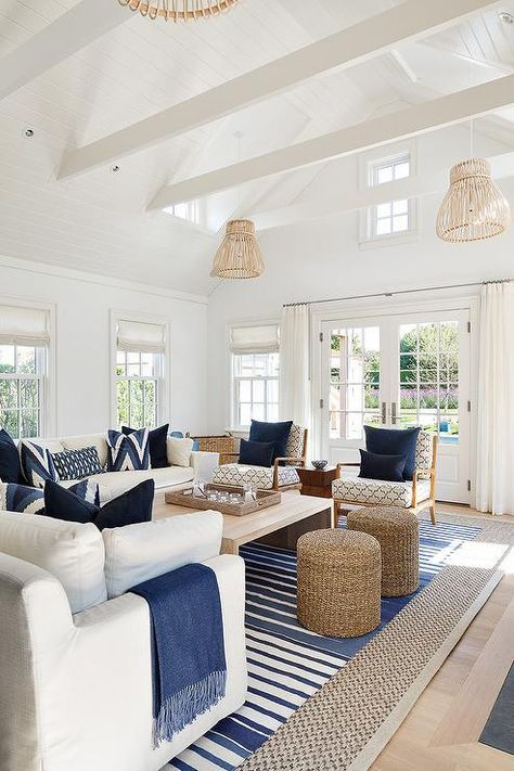 White and blue cottage living room features white ...