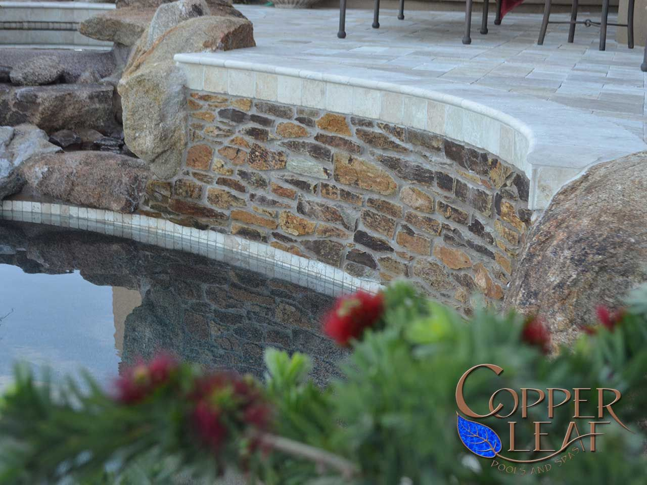 natural stone - arizona schist stone on raised pool wall. - www
