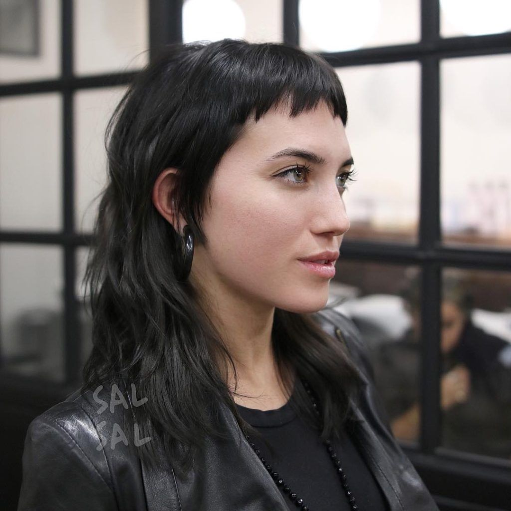 edgy modern textured mullet with choppy micro bangs and
