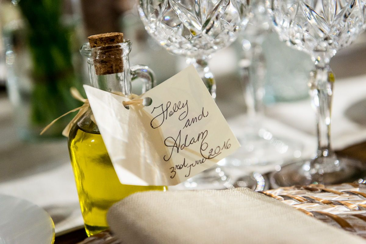 Table decoration detail olive oil bottle. Wedding in Montecarlo ...