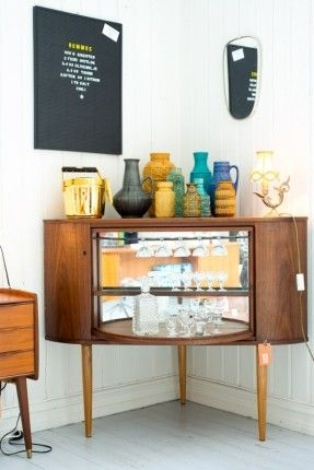Mid Century Modern bar is a corner liquor cabinet that resembles ...
