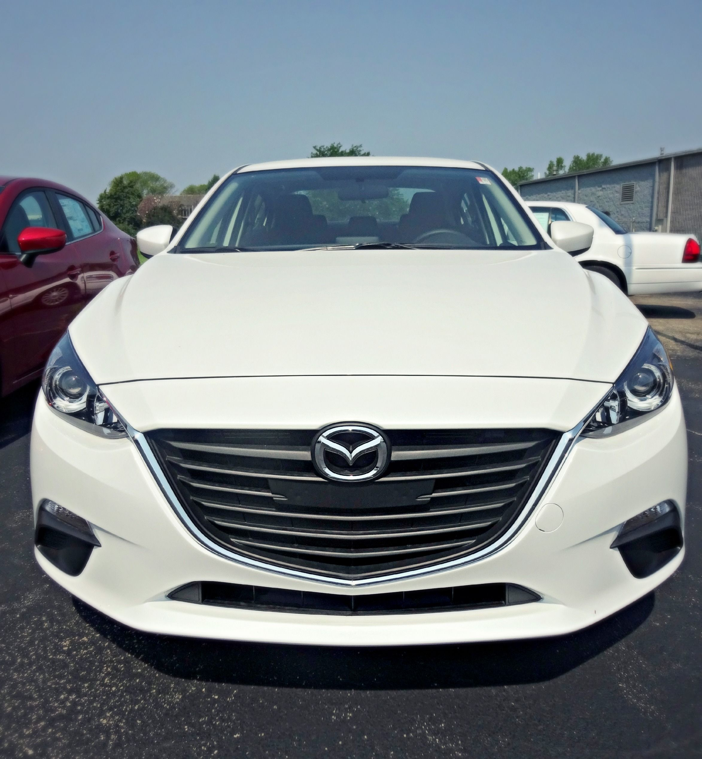 The 2014 Mazda Mazda3 i Touring at Napleton Autowerks Bourbonnais.