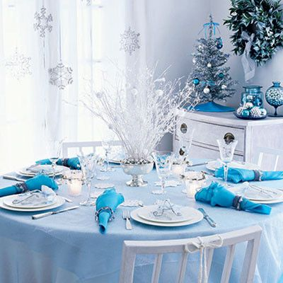 Top 100 Christmas Tables - Christmas Decorating - Style Estate - Nice look,  with a couple of teeny blue bulbs in the centerpiece that match the napkins  ...