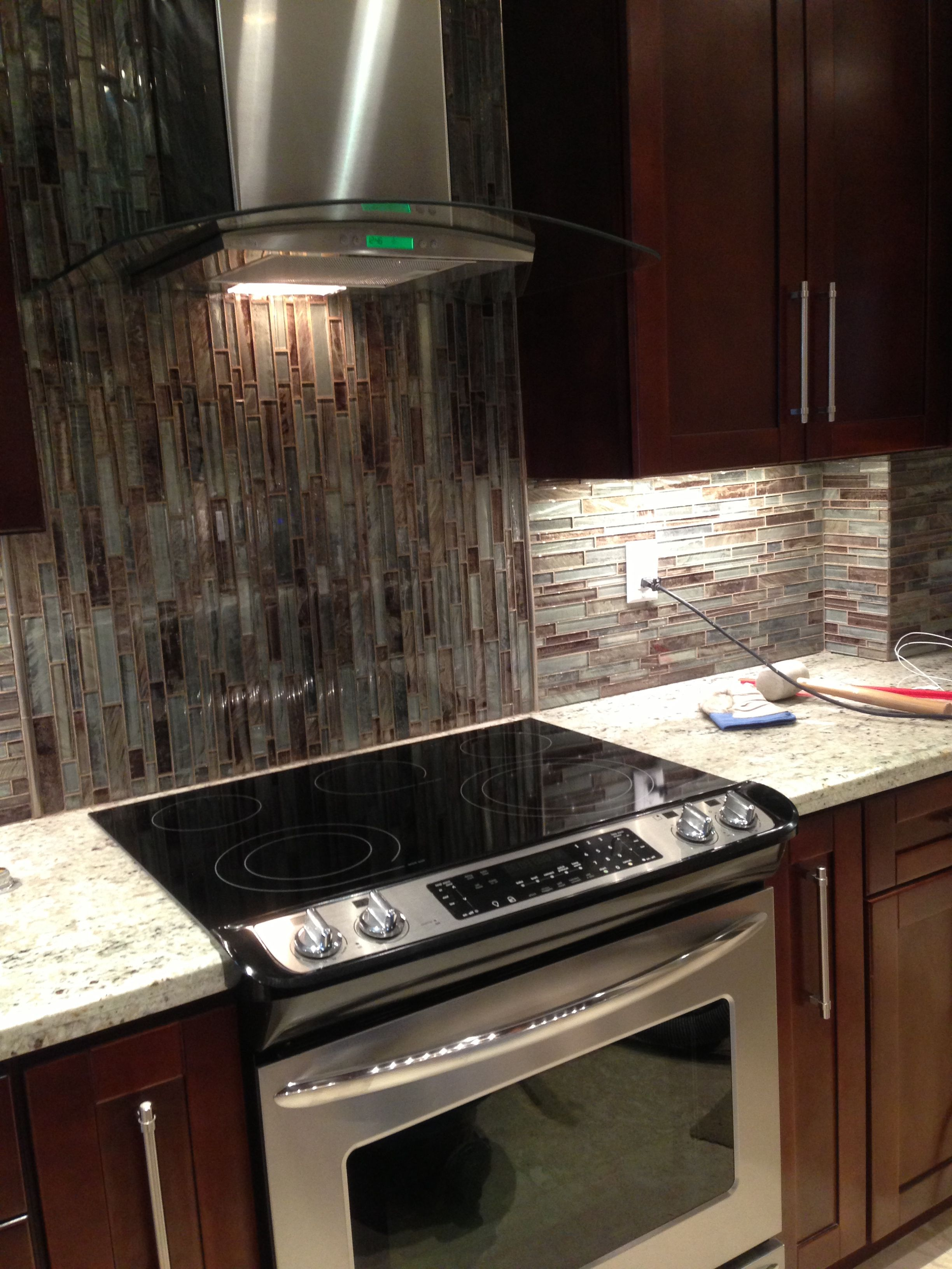 Newly Remodeled Galley Kitchen With Glass Backsplash And