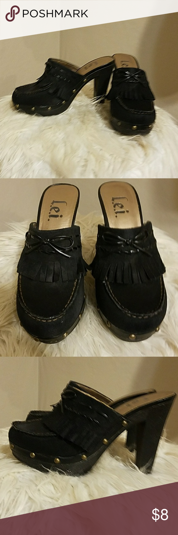 Heels Black suede with tassels.  Small gold emblems around the bottom L.e.i. Shoes Mules & Clogs
