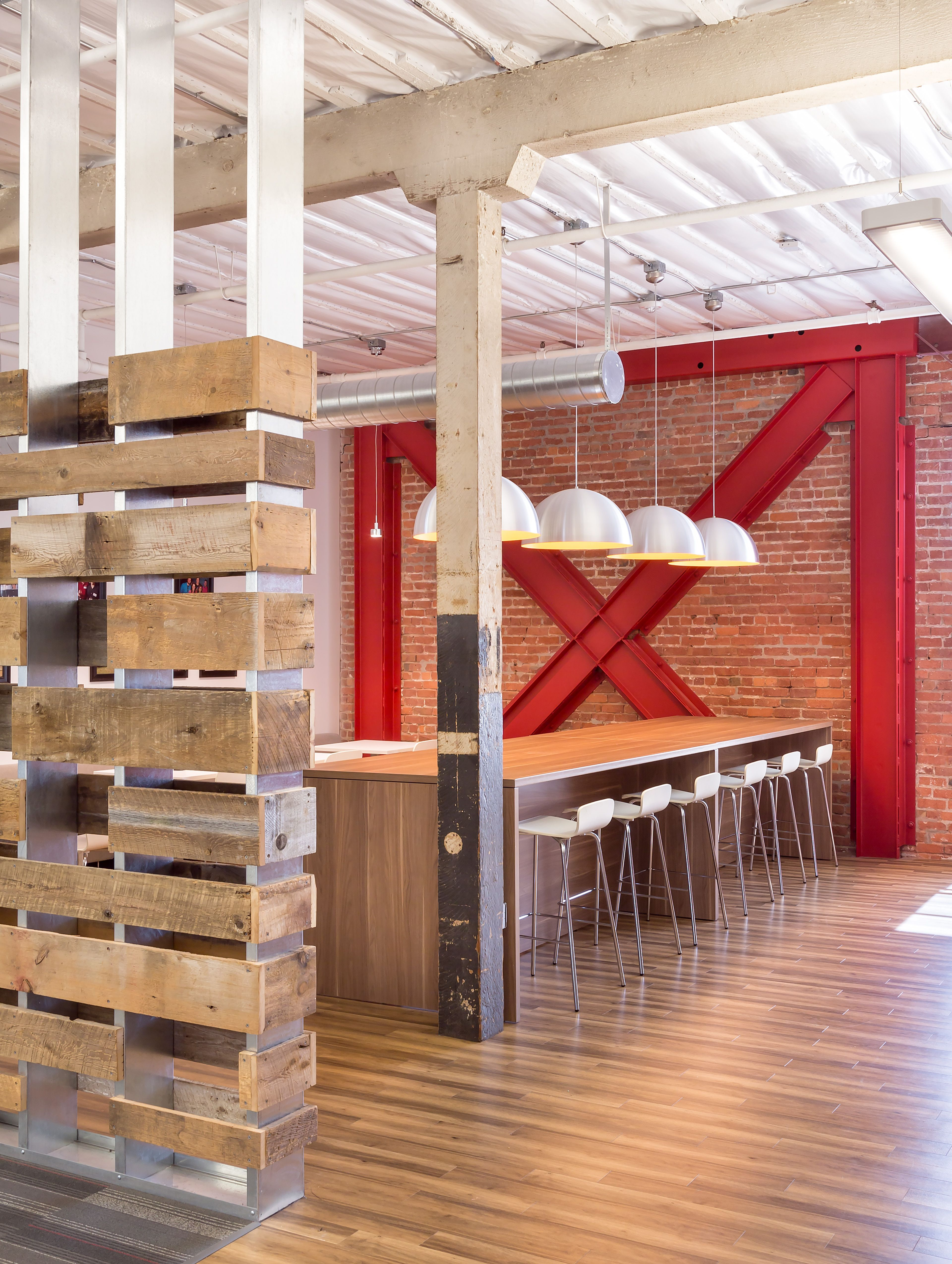 An Open Office Environment With Original Brick Walls And Wood