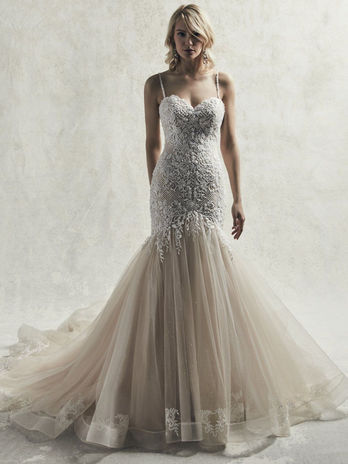 e698240ed2dd Sottero and Midgley - WARNER This exquisite mermaid wedding gown features a  bodice accented in beaded lace motifs, crosshatch detail and Swarovski  crystals, ...