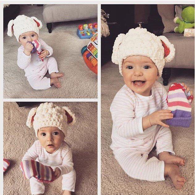This little lovable lamb enjoying her blocks and fluffy ears.