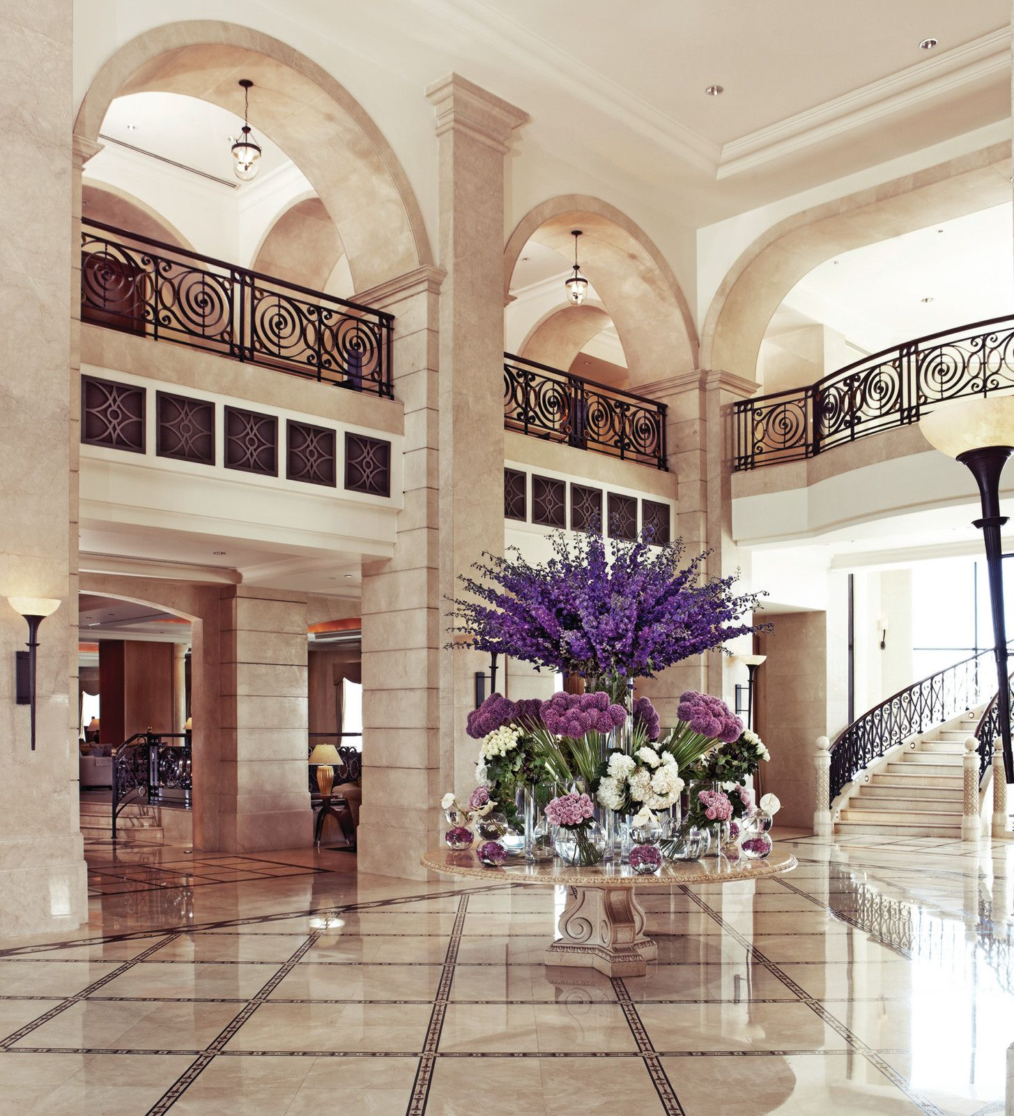shades of purple in the lobby of four seasons hotel amman - Purple Hotel Decor