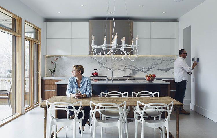 Modern Kitchen Marble Backsplash on a peaceful wooded lot, a futuristic toronto home is buzzing