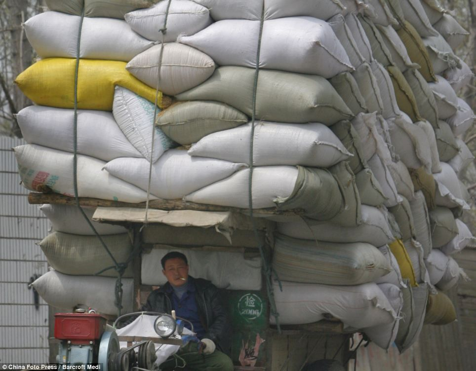 man carrying loads of bags - Google Search