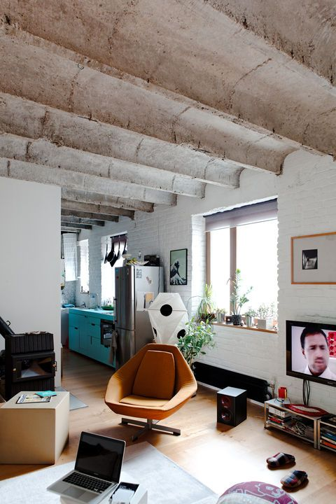 """Despite the sorry state of thisBratislava apartment, architect Lukáš Kordík """"had a feeling it could be easily turned into a cozy and open space."""" By removing a few walls and emphasizing the 1930s flat's existing rough-hewn charm, he's done just that.    This originally appeared in True Value."""