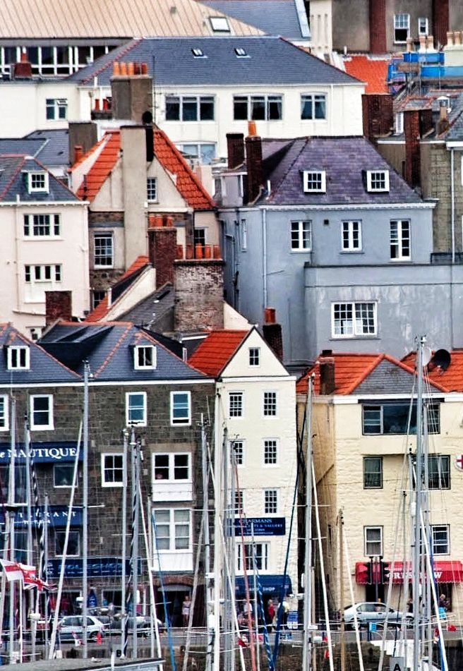 ada515872fd4 Painterly Buildings line the shore of St. Peter Port, Guernsey, Channel  Islands