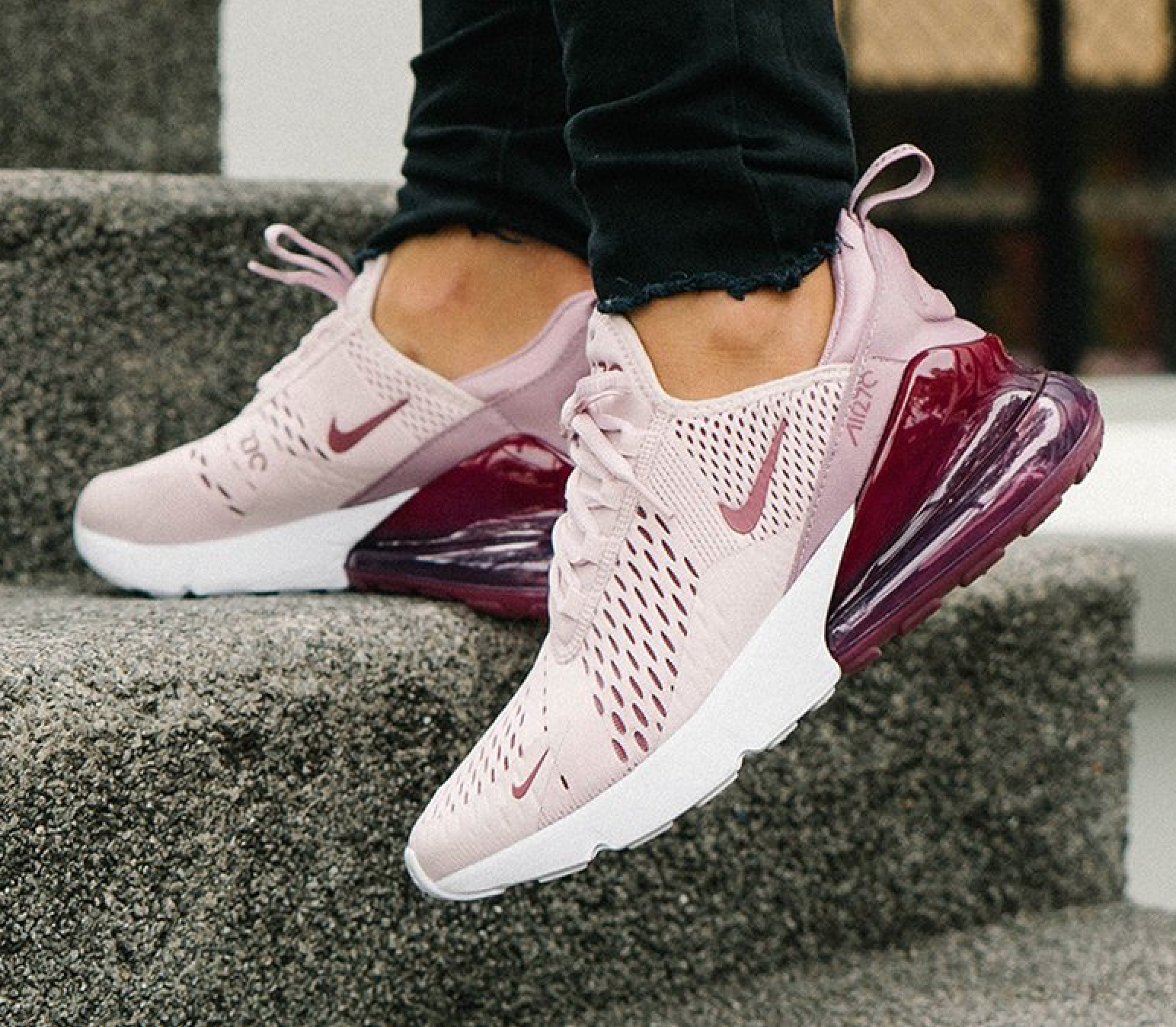 finest selection 5e084 4a5b0 Cool Nike Air Max 270 shoes Barely Rose walking up street steps in black  jeans.