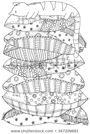 Sleeping cat on a pile of pillows. Pattern for coloring