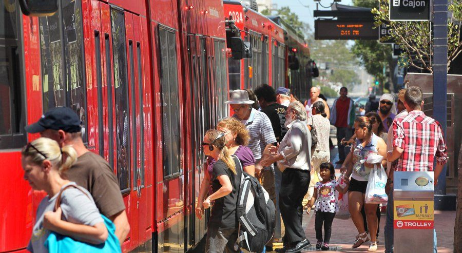 Passengers get on the Trolley that runs along C Street at the 5th. Avenue Station. The San Diego Association of Governments approved a plan with $204 billion in transportation funding, including $100 billion for mass transit.